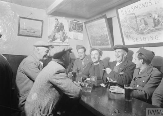 Off Duty picture Locals and United States troops meet at the Dove Inn, Burton Bradstock, Dorset, 1944.